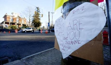 A sign on a post showed support for the victims.